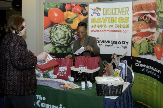 Dawn Pittman-Macin, program specialist with Defense Commissary Agency, explains the benefits of the agency's resources and programs to Carol Janer of the AFAP conference staff.