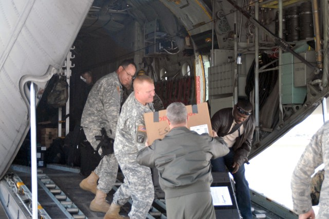 MIAMI (Jan. 13, 2010) -- A U.S. Southern Command assessment team boards a C-130 Hercules aircraft en route to Haiti to support U.S. relief efforts there following the massive Jan. 12 earthquake that devastated the Caribbean nation. The team will work with U.S. embassy personnel as well as Haitian, United Nations and international officials to assess the situation and facilitate follow on U.S. military support.