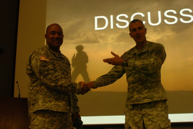 FORT CARSON, Colo. - The 4th Infantry Division and Fort Carson Deputy Commanding General of Support Brig. Gen. James Pasquarette thanked Col. Darryl Williams, deputy director of the Comprehensive Soldier Fitness program, for speaking to Mountain Post Soldiers, leaders and Department of Defense civilians about the elements of the Army's newest total health initiative during a leader professional development session at the 4th Inf. Div. Headquarters building Jan. 13. (U.S. Army photo by Spc. Shameka Edwards, 4th Inf. Div. PAO)