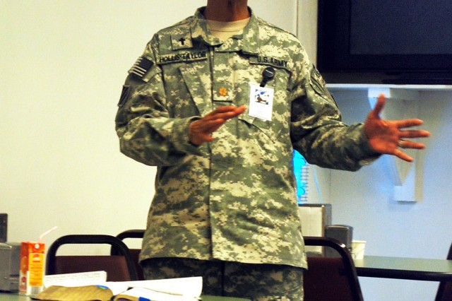 Chaplain (Maj.) Grace Hollis-Taylor, HHC, 3rd CAB, TF Falcon, speaks to Soldiers on the importance of being prepared for the unexpected during the prayer breakfast at the Marne CafAfA dining facility, Bagram Airfield, Afghanistan, Jan. 7.