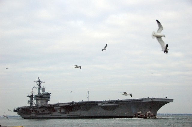 NORFOLK (Jan. 12, 2009) The Nimitz-class aircraft carrier USS Carl Vinson (CVN 70) departs Naval Station Norfolk. Carl Vinson is underway following a four-year refueling and complex overhaul to take part in Southern Seas 2010. After completing Southern Seas, Carl Vinson will change homeport from Norfolk, Va. to San Diego, Calif. (U.S. Navy photo by Mass Communication Specialist 2nd Class Rafael Martie/Released)