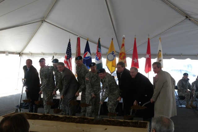 Officials take the first ceremonial dig, signifying the beginning of construction for the AMC band facility at Redstone Arsenal, Ala. U.S. Army Photo by AMC Public Affairs.   Officials participating in the ground breaking included: Maj. Gen. Todd Semonite, U.S. Army Corps of Engineers; Ronnie Chronister, U.S. Army Aviation & Missile Command; Chief Warrant Officer 4 Frederick L. Ellwein, commander, U.S. Army Materiel Command Band; John B. Rogers, Civilian Aide to the Secretary of  the Army - North Alabama; Brig. Gen. Christopher Tucker, commanding general, U.S. Army Security Assistance Command; Mayor Paul Finley, City of Madison; Mayor Tommy Battle, City of Huntsville; Col. Robert M. Pastorelli, U.S. Army Garrison Redstone Arsenal commander; Chief Warrant Officer 4 Peter Gillies, U.S. Army Materiel Command; and Bob Ratliff, Dyson Construction.
