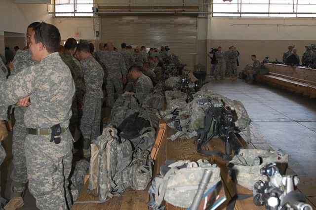 Paratroopers of Bravo Troop, 1-73 Cav, 2nd Brigade Combat team, 82nd Airborne Division, wait at Green Ramp at Pope Air Force Base early Thursday morning Jan 14, to deploy in support of the earthquake that occurred in the  capital of Port-au-Prince, Haiti.  The 2nd BCT is the 82nd Airborne Division's Global Response Force that has been training for real world emergency response missions.