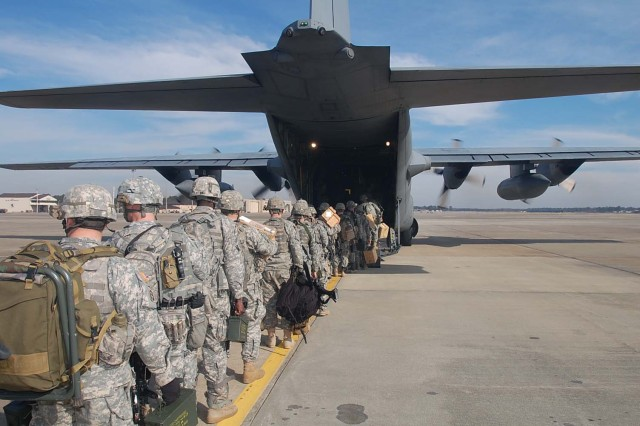 Paratroopers of Bravo Troop, 1-73 Cav, 2nd Brigade Combat team, 82nd Airborne Division, board onto a C-130 Hercules aircraft at Pope Air Force Base  early Thursday morning Jan 14, to deploy in support of the earthquake that occurred in the  capital of Port-au-Prince, Haiti earlier this week.  The 2nd BCT is the 82nd Airborne Division's Global Response Force that has been training for real world emergency response missions.  These are the first group of paratroopers going to Haiti to provide Humanitarian Aid.