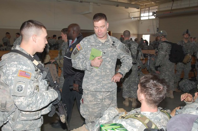 Col. Christopher Gibson, (center) commander of the 2nd Brigade Combat Team, 82nd Airborne Division, talks with Sgt Todd Thomas (left) and Spc Mitchell Turner both of Bravo Troop 1-73 Cav, 2nd BCT.  Gibson gave comfort and motivation to the young paratroopers before they deploy to Haiti to provide security and humanitarian aid.