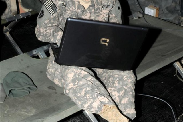 Cpl. Dawn M. Salazar, a combat medic with the 36th Sustainment Brigade personal security detachment and an El Paso, Texas, native, gets caught up on her schoolwork during a break in mission Jan. 8 at Contingency Operating Location Kalsu, Iraq.