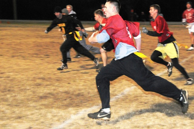 Thundercats' Joe Hall breaks loose on a punt return late in the installation's intramural football championship game Jan. 6. The big return set up a quick fourth-quarter score, helping the 'Cats rally.