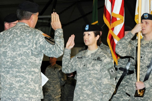 Vice Chief of Staff of the Army Gen. Peter W. Chiarelli swears in Brig. Gen. Colleen McGuire as the Provost Marshal General of the Army.