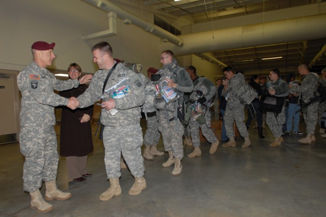 Lt. Gen. Frank Helmick, commander, XVIII Airborne Corps, shakes the hands of Soldiers from 3rd Battalion, 321st Field Artillery Regiment, 18th Fires Brigade, as they deploy from Pope Air Force Base in support of Operation Enduring Freedom, Jan. 3.