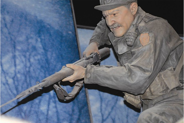 Along the dimly lit incline, visitors can hear recordings of gunfire and shouts playing over battle video. Lifelike mannequins dressed in period uniforms bring a dose of eerie authenticity, making it feel as if you're on the battlefield.The remaining scenes on The Last 100 Yards include a Korean War skirmish, a Vietnam-era Huey helicopter landing and a Bradley Fighting Vehicle, which got hit by a roadside bomb in Iraq about six years ago. Salvaged from an Army depot in Texas, it was airlifted into place as the museum's first display prior to opening. The Bradley is a symbol of Infantry operations in the Gulf War, Iraq and Afghanistan.I was drawn to a prototype called the Belly Flopper, a two-man automatic weapons carrier developed here in 1937. The vehicle resembles the lunar rover used by astronauts during the Apollo moon landings. It never went into production but inspired the manufacture of the famous World War II jeep.In a glass-enclosed space on the museum's lower level sits the Hall of Valor, which pays homage to 1,500 Medal of Honor recipients.