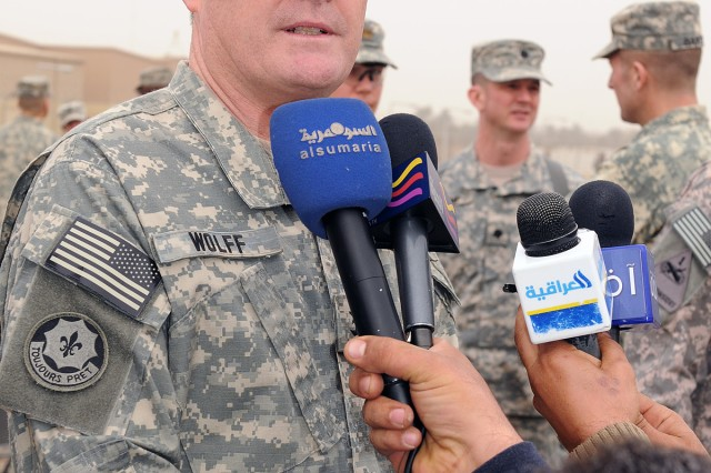 BAGHDAD - Maj. Gen. Terry Wolff, commander of 1st Armored Division, talks with members of the Iraqi press corps Jan. 13, at Camp Liberty, after a transfer of authority ceremony. The ceremony signifies that 1st Armd. Div. has assumed responsibility of U.S. Division-Center operational environment from 1st Cavalry Div. (U.S. Army photo by Sgt. 1st Class Kristina Scott, 366th MPAD, USD-C)