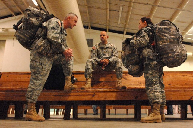 Army Lt. Col. Lisa Garcia, 18th Airborne Corps, talks with other senior leaders while she waits to deploy from Fort Bragg, N.C., Jan. 15, 2010. The Corps deployed the 82nd Airborne Division's 2nd Brigade Combat Team to support relief efforts in