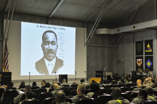 Soldiers begin to take their seats at the beginning of the Martin Luther King presentation given during the holiday on Camp Bondsteel, Kosovo.