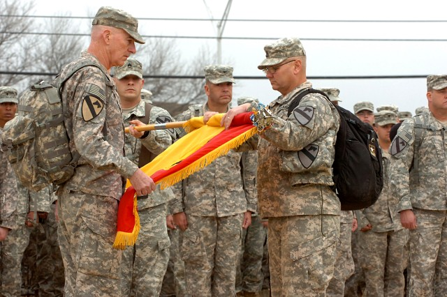 Maj. Gen. Daniel Bolger (left), the 1st Cavalry Division commanding general, and Command Sgt. Maj. Rory Malloy, the division sergeant major, uncase the division's colors, signifying their return from combat operations during their homecoming ceremony, Jan. 14, on Cooper Field at Fort Hood.