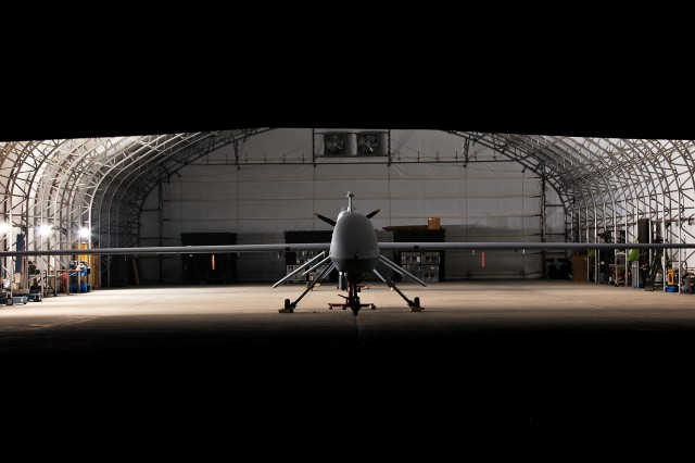 CAMP TAJI, Iraq - An MQ-1C Sky Warrior unmanned aircraft system from Quick Reaction Capability 1, attached to 1st Air Cavalry Brigade, 1st Cavalry Division, U.S. Division - Center, sits dormant in a hanger. The Sky Warrior aircraft has the ability to remain airborne for up to 24 hours straight to conduct continuous missions in support of Operation Iraqi Freedom.
