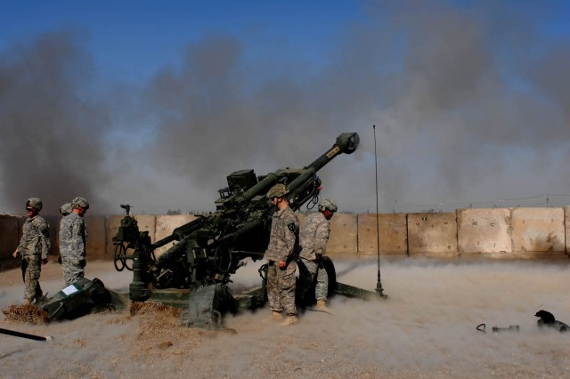 CAMP TAJI, Iraq - Soldiers from 2nd Battalion, 12th Field Artillery Regiment, 4th Stryker Brigade Combat Team, 2nd Infantry Division, fire their first live round in country in support of 1st Brigade Combat Team, 1st Cavalry Division during a joint fires exercise Jan. 10.