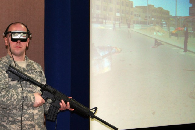 """Sgt. Matthew Payne demonstrates the """"Virtual Iraq"""" program, a computer simulation that allows behavioral therapists to use Virtual Reality Exposure Therapy to treat patients suffering from PSTD. The Department of Defense National Center for Telehealth and Technology is currently conducting a study to determine the effectiveness of VRET for active-duty servicemembers."""