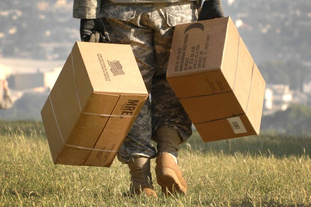 U.S. troops deliver food to quake victims
