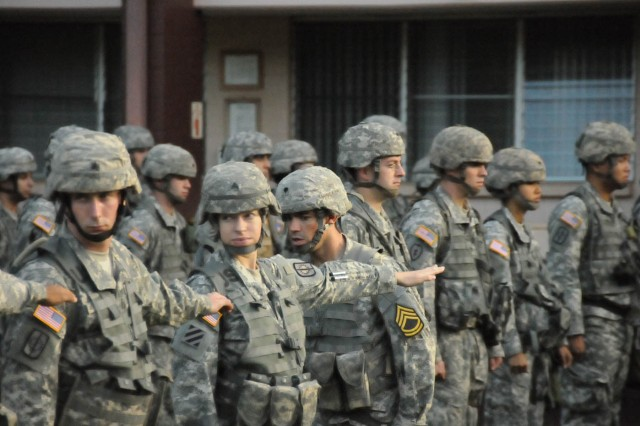 A sergeant aligns his squad members during an open ranks inspection Jan. 11 at the Noncommissoned Officer Academy, Hawaii.