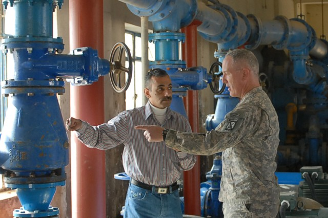 BAGHDAD - Mohamad Ibraheem, an engineer for National Chemical Plastic Industry Company, takes Lt. Col. Michael Davey, of Peru, N.Y., the deputy commander of 2nd Brigade Combat Team, 10th Mountain Division, on a tour of the facility Jan. 18, showing the operations and improvements being made in the water treatment facility. The facility project is 78-percent complete and is scheduled to be operational in the next 30 days. (U.S. Army photo by Georges Aboumrad, 2nd BCT PAO, 10th Mtn. Div. USD-C)