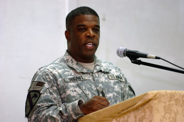 """CAMP TAJI, Iraq - Sgt. Maj. Gary Durant, from Pittsburgh, command sergeant major for 115th Brigade Support Battalion, 1st Brigade Combat Team, 1st Cavalry Division, U.S. Division - Center, recites a portion of Martin Luther King's """"I Have A Dream"""" speech as part of the 1st Air Cavalry Brigades' Martin Luther King Jr. Observance at the Taji Ministry Center Jan.18.  (U.S. Army photo by Sgt. Alun Thomas, 1st  ACB, 1st Cav. Div. Public Affairs)"""