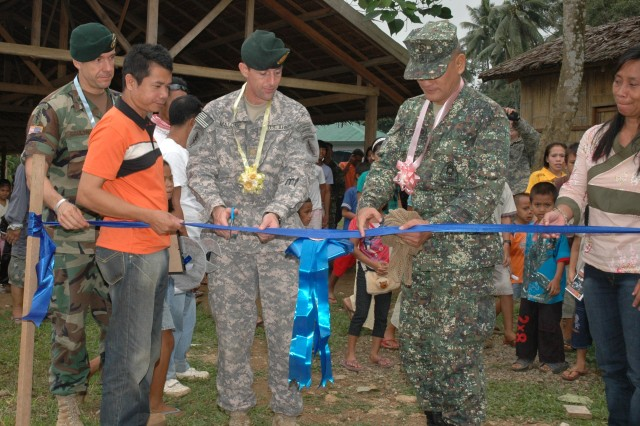 100114-F-2362L-090 JOLO, Philippines (Jan. 14, 2009) U.S. Army Col. Bill Coultrup and Maj. Scott Malone, both from Joint Special Operations Task Force-Philippines, assist Brig. Gen. Rustico Guerrero with cutting a ribbon during the dedication of the Kagay Elementary School.  Constructed by Navy Seabees from Naval Mobile Construction Battalion (NMCB) 1 out of Gulfport, Miss., about 30 Sailors here are on an eight-month deployment, working on a variety of humanitarian construction projects. (U.S. Air Force photo by Lt. Col. Jerry Lobb/Released)