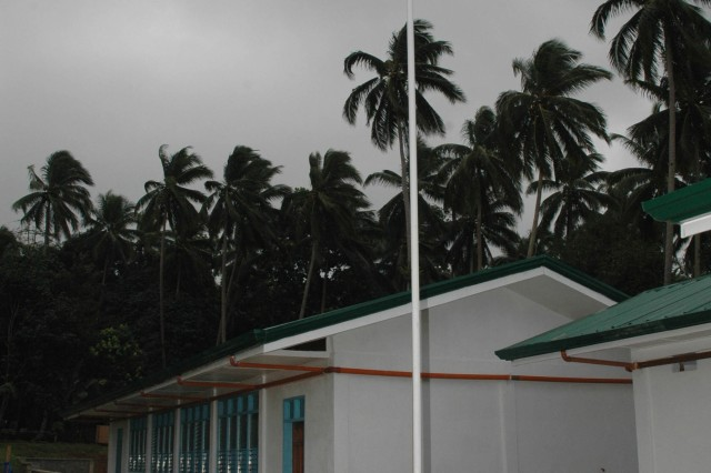 100114-F-2362L-021 JOLO, Philippines (Jan. 14, 2010) The Philippine flag flies over a newly- constructed school in Barangay (community) Kagay.  The building is one of two classroom buildings turned over during a brief ceremony to local officials by senior officers of the Armed Forces of the Philippines and Joint Special Operations Task Force-Philippines.  The school was built by JSOTF-P Navy Seabees from Naval Mobile Construction Battalion (NMCB) 1 out of Gulfport, Miss. (U.S. Air Force photo by Lt Col Jerry Lobb/Released)