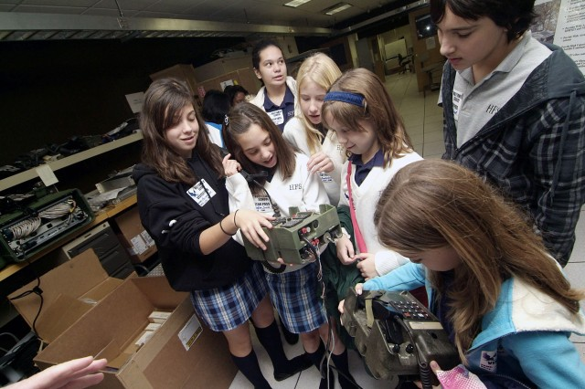 Holy Family students participate in hands-on activities provided for them during their CERDEC tour of the Space and Terrestrial Communications Directorate Communications System Design Center.