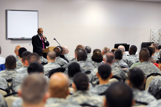 """The Rev. Dr. Goodwin Douglas speaks to the assembled crowd during Fort Detrick's Jan 14. luncheon honoring the late Dr. Martin Luther King, Jr. titled """"Remember! Celebrate! Act! A Day On, Not A Day Off."""""""