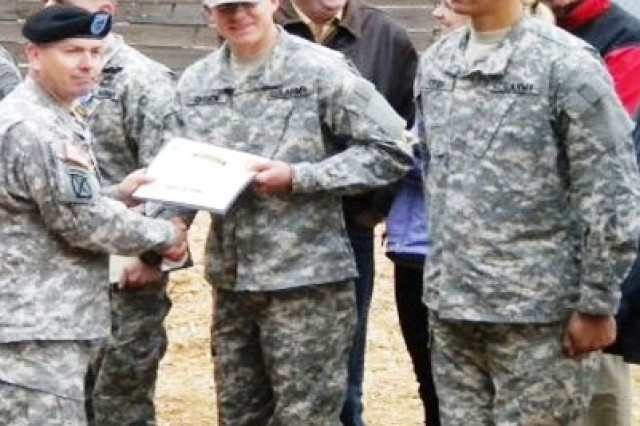 First Lt. Sean Curnow receives an award at his Dec. 11 Ranger School graduation at Fort Benning, Ga. Curnow garnered two honors for leadership and excellence during training.