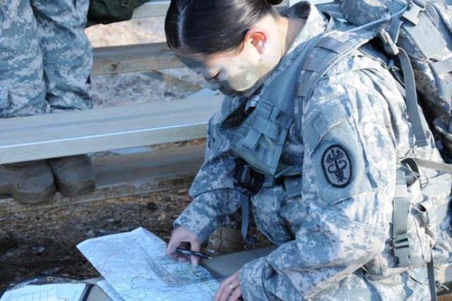 Staff Sgt. Sarah Patrick plots her land navigation route Jan. 12 during a competition at the Hwy. 27 Warrior Trace Land Navigation Course. For more event photos, visit the Army Flier Facebook page and become a fan.