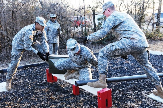 Soldiers compete in a Leadership Reaction Course Jan. 14 as part of last week's Southeast Regional Veterinary Command and Army Dental Lab Soldier and NCO of the Year Competition.