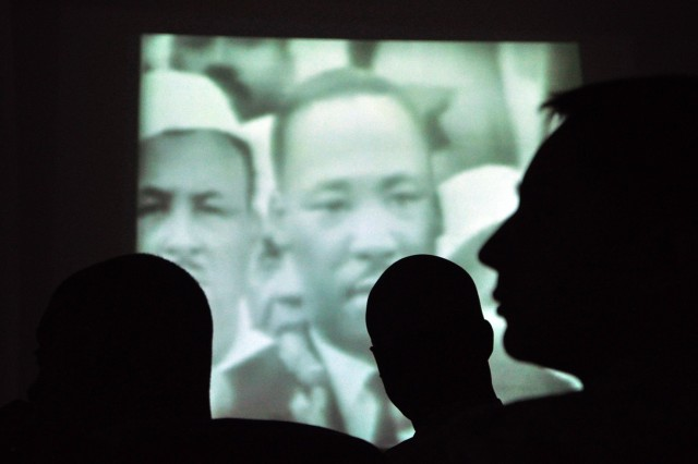 """Soldiers watch a recording of Martin Luther King Jr.'s famous """"I Have a Dream"""" speech at an observance at the Morale Welfare and Recreation tent here Jan. 18 hosted by the 15th Special Troops Battalion, 15th Sustainment Brigade, 13th Sustainment Command (Expeditionary)."""