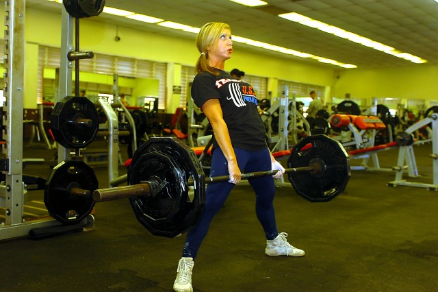 Jonna Ocampo, military spouse and three-time Team USA gold medalist, practices her dead lift at the Martinez Physical Fitness Center at Schofield Barracks, Hawaii, Jan. 14. Ocampo has competed worldwide in many powerlifting competitions and ranks 6th best in the world for her weight class. (U.S. Army photo by Spc. Jesus J. Aranda, 25th Infantry Division Public Affairs.)