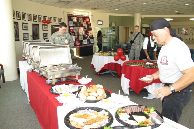 Ronald Decker picks up hors d'oeuvres after the Blood Donor Recognition Ceremony at Robertson Blood Center at Fort Hood, Texas on January 21, 2010.
