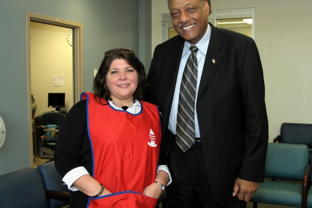 Top volunteer Donna Smith poses with the vest designed by retired Colonel Tony Polk, first blood program officer at Fort Hood after the National Blood Donor Recognition Ceremony at the Robertson Blood Center on January 21, 2010.
