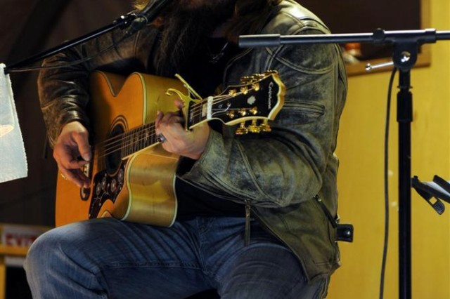 Country singer Jamie Johnson performs at the Jan. 17 United Service Organizations concert at Memorial Hall at Camp Adder, Iraq.