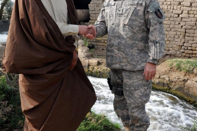 Shaykh Uday Aber Fahed Al Shrshap, of the Bdure Tribe, takes Col. Sean A. Ryan, commander of the 36th Sustainment Brigade out of Temple, Texas, 13th Sustainment Command (Expeditionary) and a Cedar Park, Texas, native, on a tour of his home Jan. 20, near Camp Adder, Iraq.