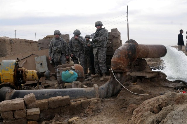 Col. Sean A. Ryan, commander of the 36th Sustainment Brigade out of Temple, Texas, 13th Sustainment Command (Expeditionary) and a Cedar Park, Texas, native, is given a tour, Jan. 18, of one of the water pumps on the Euphrates River that supplies water to Camp Adder, Iraq.