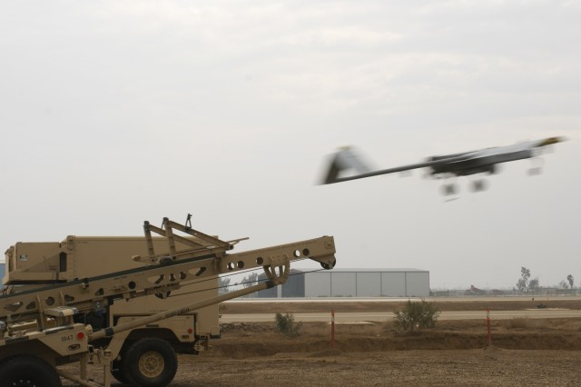 CAMP TAJI, Iraq - A Shadow unmanned aerial system takes off in a blur from a launch pad Jan. 15. Soldiers from several units, including 4th Stryker Brigade Combat Team, 2nd Infantry Division, work together and operate the launch pad. (U.S. Army photo by Pfc. Kimberly Hackbarth, 4th SBCT PAO, 2nd Inf. Div.)
