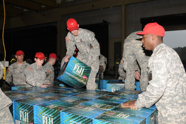 Soldiers from Fort Bragg's heavy-rig site load cases of bottled water Jan. 21, to be delivered to Haiti in support of humanitarian relief efforts in the earthquake ravaged country. More than 200,000 bottles of water were delivered earlier in the week because of the efforts of two Fort Bragg Soldiers and their family member who requested their assistance in providing help to Haiti.