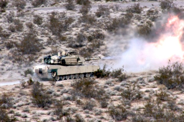 FORT IRWIN, Calif. - An M1A1 tank from C Troop, 1st Squadron, 11th Armored Cavalry Regiment, engages a target while moving from one firing point to another during a qualification live-fire gunnery at the Range 1 facility here, Jan. 7. (Photo by Spc. Nathanial Muth, 11th ACR Public Affairs)