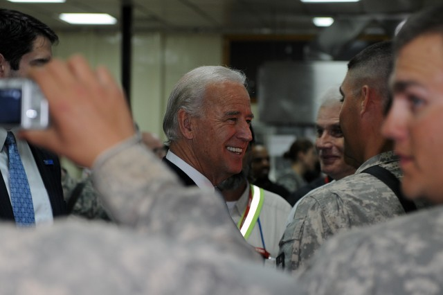 Vice President Joe Biden takes time to chat with Soldiers during his visit to Camp Liberty Iraq, Jan. 23. Despite having a busy schedule he still managed to find to time to visit the Soldiers stationed there.