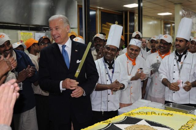 Biden cuts a cake