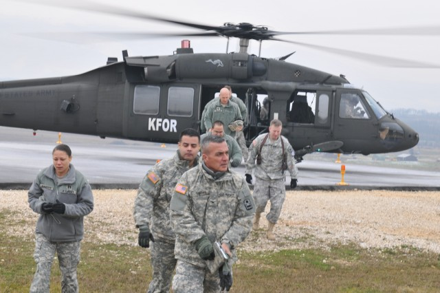 """CAMP BONDSTEEL, Kosovo - U.S. Army Col. Victor Torres led about a dozen Soldiers from the Puerto Rico-based 92nd Maneuver Enhancement Brigade (MEB) on a recent visit here. It was the Soldiers\' first look at what eventually will be their duty station when they take over NATO peacekeeping responsibilities later this year from the North Dakota-based 141st Maneuver Enhancement Brigade of KFOR 12 (Kosovo Forces) The Puerto Rican unit, the largest in the U.S. territory's Army National Guard, will be part of the KFOR 13 rotation in Multi-National Battle Group-East, based at Camp Bondsteel. Torres was accompanied on the visit by Col. Orlando Izquierdo, the Battle Group's judge advocate general, and Command Sgt. Maj. Gilbert Arocho. """"This trip will help me to prepare my Soldiers for their next mission, KFOR13,"""" Torres said. """"This helps us get a much better view and understanding of the duties and responsibilities for each of my Soldiers."""" As part of the visit, the KFOR 13 Soldiers were treated to an orientation briefing about Camp Bondsteel, the region of Kosovo, the NATO mission in Kosovo and a tour of the base. They also received an aerial tour over southeastern Kosovo aboard a UH-60 Blackhawk, before returning for more meetings with the KFOR 12 Soldiers they will be replacing. Other members of KFOR 13 who participated in the visit were: Capt. Omar Lorenzo, Maj. Rolando Vargas, Lt. Col. Orlando Nigaglioni, Lt. Col. Bienvenido Serrano-Castro, Maj. Higinio Figueroa, Lt. Col. Timothy Taylor, Sgt. 1st Class Robert Waller, Maj. Luis Martinez and Capt. Margaret Bundesen. """"It was a pleasure to welcome our guests from the Puerto Rican Army National Guard and other units that make up the 92nd Maneuver Enhancement Brigade of KFOR 13,"""" said Brig. Gen. Al Dohrmann, commander of Multi-National Task Force-East (KFOR 12). """"It was not long ago that we were in their shoes, eagerly learning everything we could about Kosovo and our mission here. I wish them all the best and nothing but succ"""