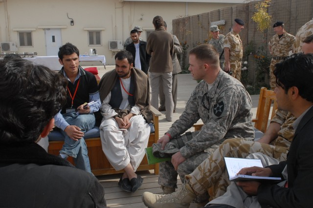 Capt. Adam Weece, public affairs officer for the 5th Stryker Brigade Combat Team in Afghanistan, meets with Afghan media in the Lashkar Gah region.