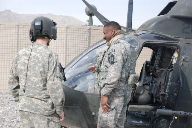 Colonel Harry Tunnell IV (right), commander of the 5th Stryker Brigade Combat Team in Kandahar, Afghanistan, prepares to board a OH-58 Kiowa helicopter for an aerial recon of his battle space.