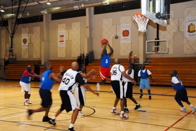 Sgt. Christopher Moore shoots a basket for the USAG-Casey basketball team during the Warrior Country Men's 33 and older basketball game, Jan. 15 at the USAG-Casey Carey Fitness Center. The Casey team won the game 46-45 and will move on to the 8th Army Championship.