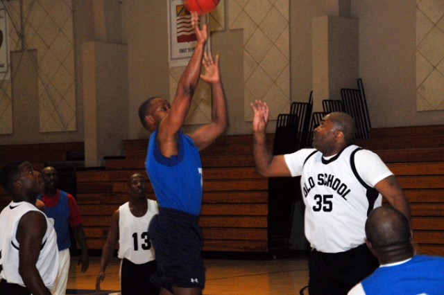 Sgt. Maj. Timothy Edwards shoots a basket in front of a defender Staff Sgt. Jereld Jones during the Warrior Country Men's 33 and older basketball game, Jan. 15 at the USAG-Casey Carey Fitness Center. The Casey team won the game 46-45 and will move on to the 8th Army Championship.