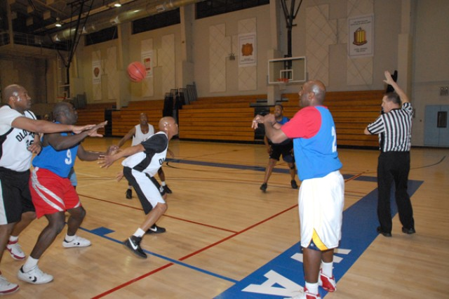 Members from the USAG-Casey prepare to inbound the ball at the Warrior Country Men's 33 and older basketball game, Jan. 15 at the USAG-Casey Carey Fitness Center. The Casey team won the game 46-45 and will move on to the 8th Army Championship.